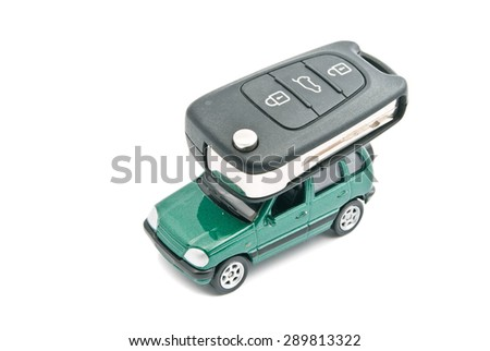 Green car and car keys on white - stock photo