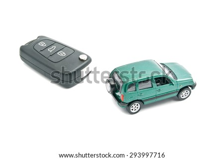 Green car and car keys with alarm on white background - stock photo