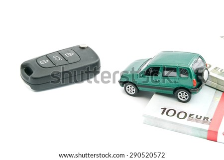 Green car, car keys and euro banknotes on white - stock photo