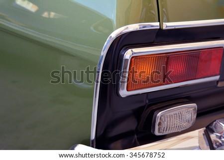 Green car macro on back lights.. - stock photo