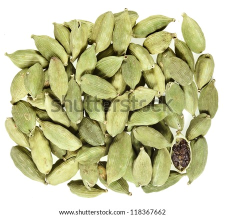 Green cardamom seeds on a white background - stock photo