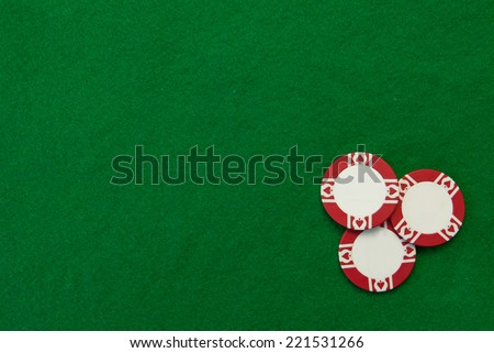 Green casino table with chips - stock photo