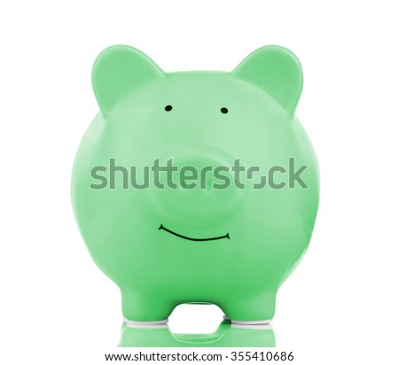 Green ceramic piggy bank isolated on white