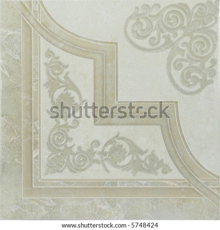 Green ceramic tile with decorations - stock photo
