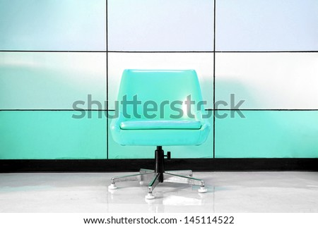 Green chair and modern wall - stock photo