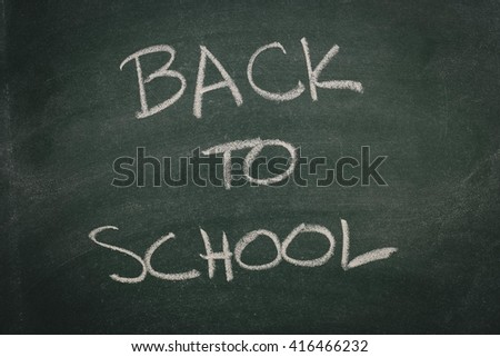 Green Chalkboard back to school - stock photo