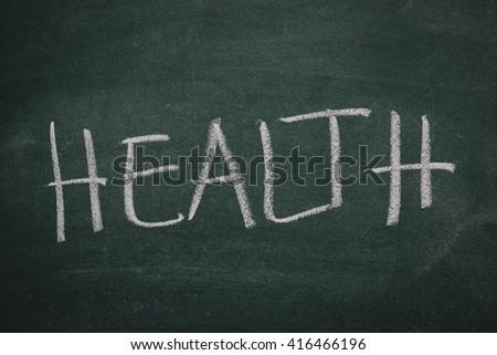 Green Chalkboard health - stock photo