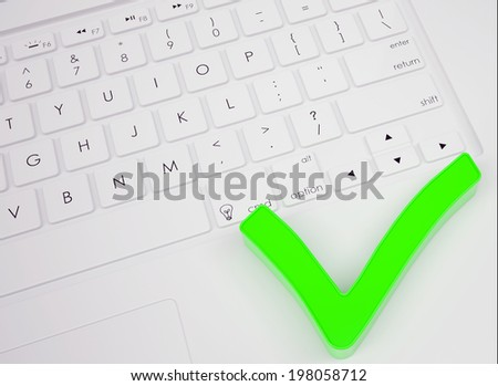 Green check mark on the keyboard. View from above - stock photo