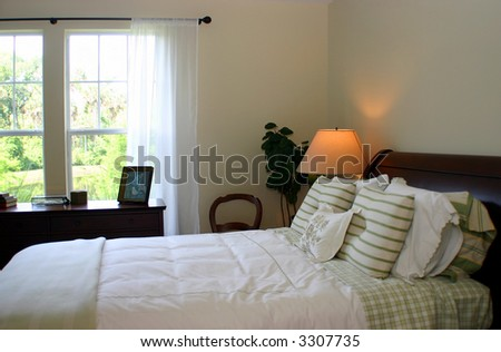 green checks and stripes bedroom - stock photo
