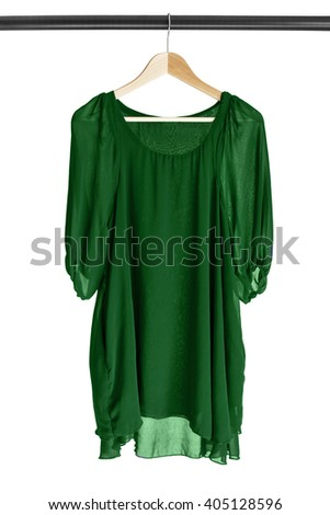 Green chiffon dress hanging on clothes rack isolated over white - stock photo