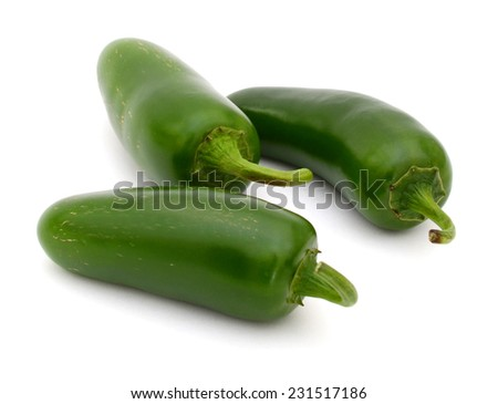 green chilies (jalapeno) on white background  - stock photo