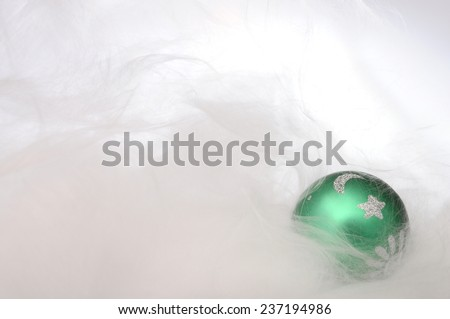 Green christmas balls on white background of angel's hair for merry christmas - stock photo