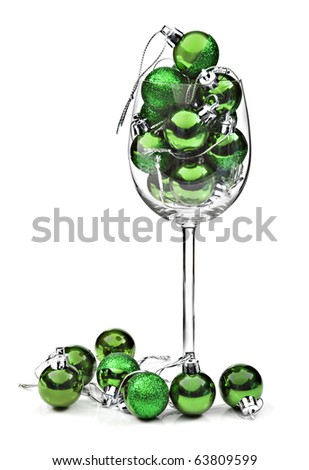 Green christmas decoration baubles on a white background with space for text - stock photo