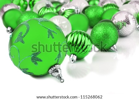 Green christmas ornament baubles on white