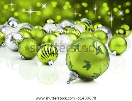 Green christmas ornaments with star background - stock photo