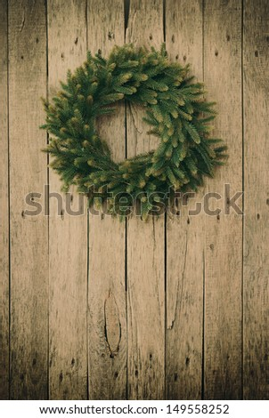 Green Christmas Wreath on a wooden planks,toned - stock photo
