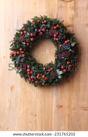 green christmas wreath on wooden wall