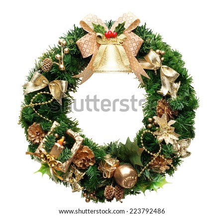 green christmas wreath with decorations isolated - stock photo
