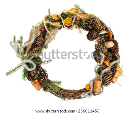 Green Christmas Wreath with Decorations Isolated on White Background. Closeup. - stock photo