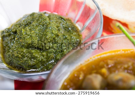 green chutney served with chickpeas and bhature - stock photo