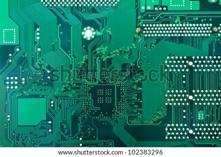 Green circuit board. - stock photo
