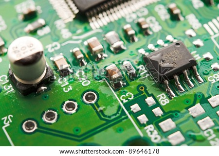 green circuit board from the computer closeup - stock photo