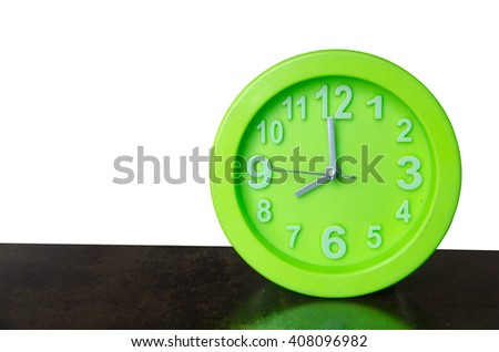 green clock on white background 8 o'clock - stock photo