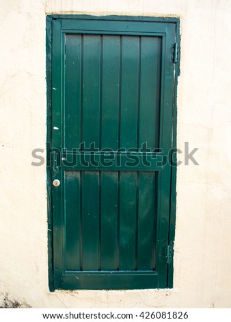 Green closed door - stock photo