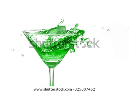 Green cocktail splash on white background close up - stock photo