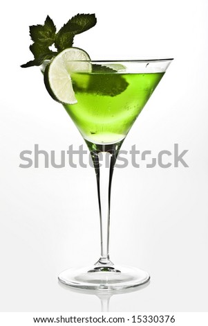 green cocktail with lemon adn mint