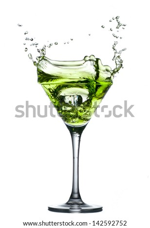 green cocktail with splashes on white