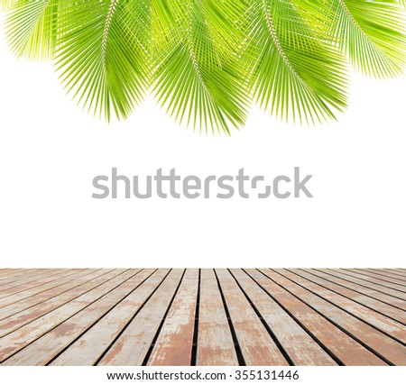 Green coconut leaves over wooden floor - stock photo