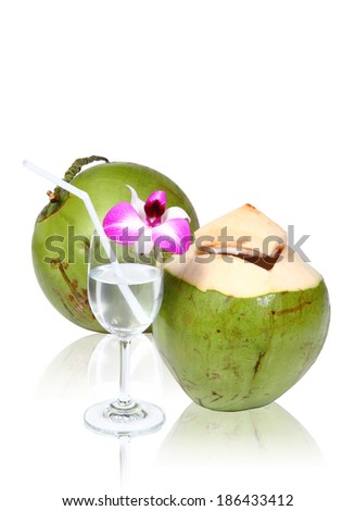 Green coconuts with drinking straw isolated, clipping path. - stock photo
