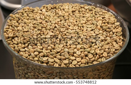 green coffee beans in a large glass bowl