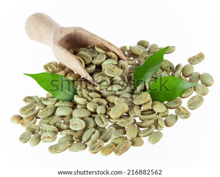 green coffee beans on white background, close-up. - stock photo
