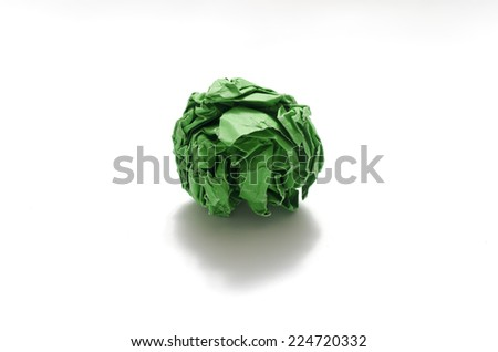 green color crumpled paper ball on a white background - stock photo
