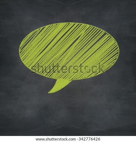 green color of chalk speech bubble on blackboard, communication concept - stock photo