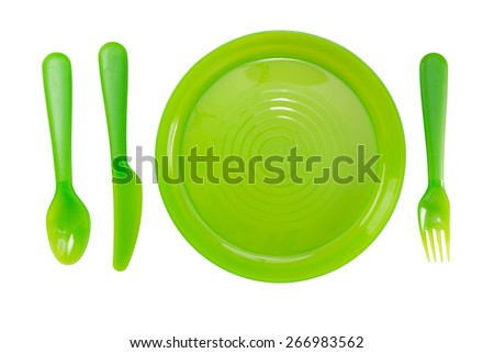 Green Color plastic plates and tableware isolate on white background - stock photo