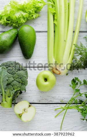 green color vegetables on white rustic boards, top view
