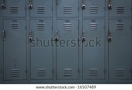 Green colored school lockers, typical of a high school. - stock photo