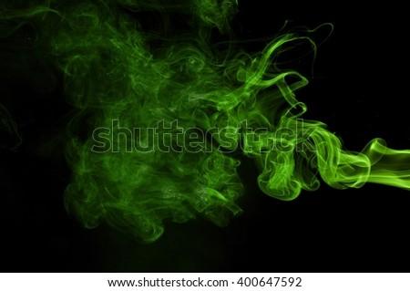 Green colored smoke on a black background, abstract cloud. Smoke design,Abstract green lighting,Green Smoke - stock photo
