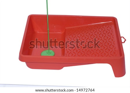 Green colour on red surface isolated over white - stock photo
