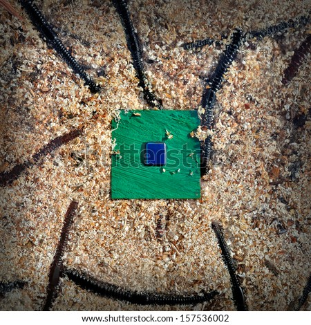 Green computer CPU chip on the center with worms - stock photo