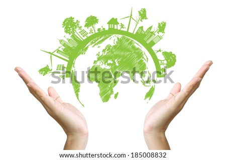 Green concept. Tree on the earth in hand - stock photo