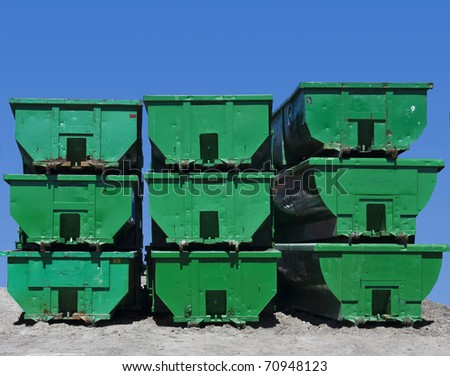Green Containers used to transport recyclable materials - stock photo