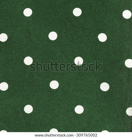 Green Cotton Jersey Fabric with White Dots Regular Pattern, Texture background, retro style  - stock photo