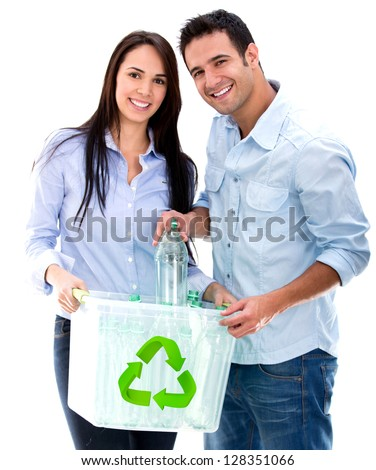 Green couple recycling bottles - isolated over a white background - stock photo