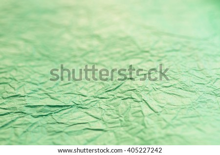 green creased paper background texture selective focus - stock photo