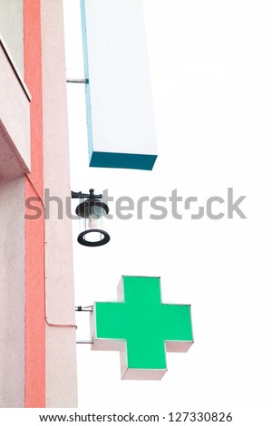 Green cross indicating the location of a pharmacy - stock photo