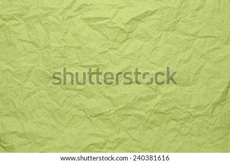 Green crumpled paper as background - stock photo